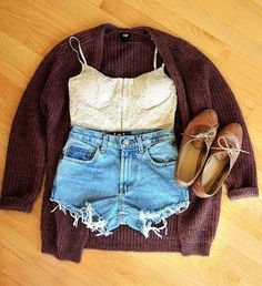 cropped white lace bustier, high waisted lightish wash cutoffs, dark colored knit cardigan