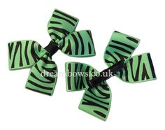 Green animal print grosgrain ribbon hair bows on alligator clips - www.dreambows.co.uk