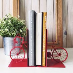 Bookends and book stands from Papemelroti Gift Shop, original designs Philippines, Art And Craft Design, Book Stands, Diy Arts And Crafts, Inspirational Gifts, Book Worms, Bookends, Bicycle, Instagram