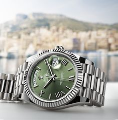 The Day-Date 40 in 18ct white gold with an olive green dial features a weekday display that is available in 26 languages.