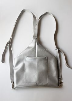 DIY Silver Backpack from Plan B anna evers | This backpack has a hidden zipper in a fold, which only allows you to open the bag taking the backpack off