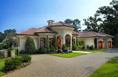 Awesome-mediterranean-home-plans-with-courtyards-designed-with-cream-wall-paint-color-combine-with-orange-clay-roof-tile.jpg 996×657 pixels