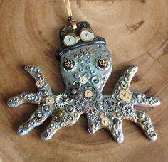 Steampunk Octopus with Top Hat, Handmade Polymer Clay Ornament with Metal Gears from Rogue Bea Studio. www.roguebea.com