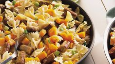 This skillet dinner has it all - pasta, sausage and squash blended in an easy meal that's ready in 45 minutes.