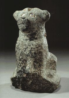 a Mespotamian green stone figure of a dog, Dynasty of Isin, Reign of Bur-Sin, 1895-1874 B.C.