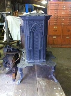 Antique Gothic style wood/coal stoves; 2 items. $200 each. Circa mid 1800's. Thin decorative cast iron has some stress cracks, but is structurally sound, just not suitable for heating application...