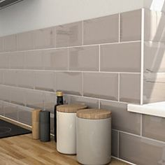 Trentie Grey Gloss Ceramic Wall tile Pack of 40 . This wall tile is ideal for bathroom shower walls & kitchen. Wall tile by Colours Grey Wall Tiles, Ceramic Wall Tiles, Grey Walls, Gray Kitchen Backsplash, Taupe Kitchen, Blue Kitchen Tiles, Grey Gloss Kitchen, Taupe Bathroom, Kitchen Worktop