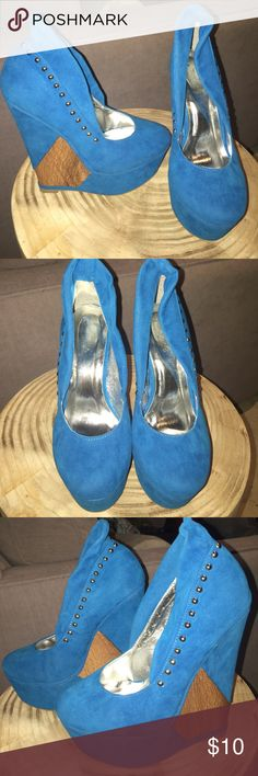 High heels BRAND NEW 6 inch heels! Round toe. Bright blue with a wood wedge part. Never used never wore. Details all over! Brand is posh Nasty Gal Shoes Platforms