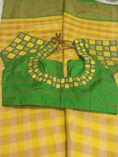 Plain blouse body with embroidered sleeves for a checks saree...