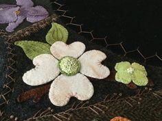 "Wool appliqué with crazy quilt stitching. Hand stitched by Mary Ann Thom. Adapted from ""Flower Garden Crazy Tablemat"" by Primitive Gatherings."