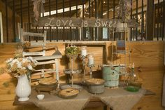 an old wooden table + burlap tablecloth would make for an adorable rustic dessert table!