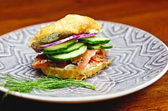 mini bagels with dill and scallion cream cheese, sliced cucumbers and lox