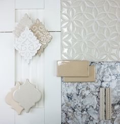 This neutral design concept features handmade subway tile and decorative tile with trim, arabesque tile, white beadboard cabinet and Cambria quartz countertop | juleptile.com