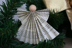 simple folded paper angel . . . a nice project for an angel tree . . . a baby mobile . . . tiny ones for a garland etc.