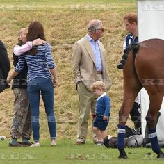 Duchess Catherine with Prince George at polo 14 Jun 2015