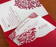 dramatic leafy red on wedding invitation and matching insert cards with a stunning pink pocket folder.  | Invitations by Ajalon | invitationsbyajalon.com