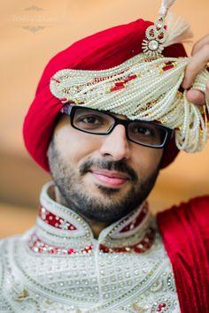 Punjabi Sikh groom raises his Sehra for the camera