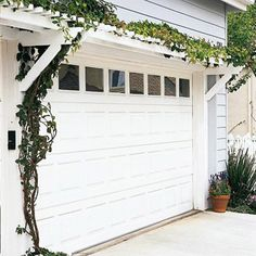 Garage Door Update - Like the addition of glass to a simple paneled door. The trellis w/ vines is a nice touch and helps to frame the door.