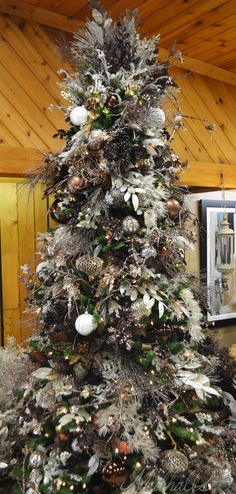 White & brown themed Christmas tree i can't imagine the money that's on this tree