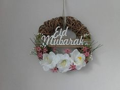 Check out this item in my Etsy shop https://www.etsy.com/listing/533571410/grapevine-wreath-with-eid-mubarak-laser