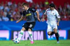 Ever Banega Photos Photos - Thorgan Hazard (L) of Borussia Monchengladbach competes for the ball with Ever Banega (R) of Sevilla FC during the UEFA Champions League Group D match between Sevilla FC and VfL Borussia Monchengladbach at Estadio Ramon Sanchez Pizjuan on September 15, 2015 in Seville, Spain. - Sevilla FC v VfL Borussia Monchengladbach - UEFA Champions League