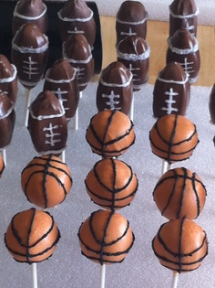 Football and basketball cake pops for sports theme baby shower.