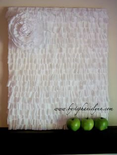 Under The Table and Dreaming: Crepe Streamer Ruffles {Inexpensive Wall Art} This could also be done using fabric.
