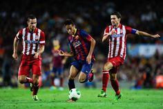Neymar (C) of FC Barcelona duels for the ball with Mario Suarez (R) and Gabi Fernandez of Atletico de Madrid during the Spanish Super Cup second leg match between FC Barcelona and Atletico de Madrid at Nou Camp on August 2013 in Barcelona, Catalonia. Barcelona Futbol Club, Madrid Barcelona, Barcelona Catalonia, Neymar, V Club, Professional Football, August 28, Mario, Spanish