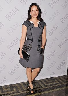 Sexy librarian: Lucy Liu wowed in a smart grey dress with a black lining while attending BAM Education's 2014 Ignite Gala in New York City on Monday night