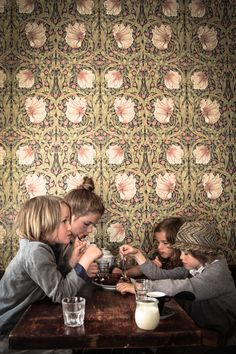 william morris wallpaper, warm wooden table, and well dressed children = <3
