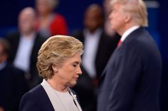 <p>Republican U.S. presidential nominee Donald Trump and Democratic U.S. presidential nominee Hillary Clinton pause at the conclusion of their presidential town hall debate at Washington University in St. Louis, Missouri, U.S., October 9, 2016. (Saul Loeb/Pool/Reuters)</p>