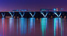 The Woodrow Wilson Bridge at night, seen from National Harbor, Maryland.