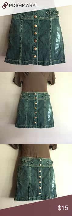Jean skirt This jean skirt by The Gap features a flattering wide waistband and brass snaps on the front panel. Length measures 14 inches. GAP Skirts Mini