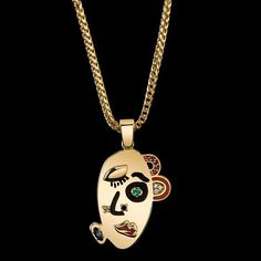 """Wink Pendant from KDIA's second collection entitled """"les artistes"""" featuring white and black diamonds, emerald, rubies and blue and yellow sapphires."""