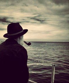 Dude with a pipe looking out to sea..................