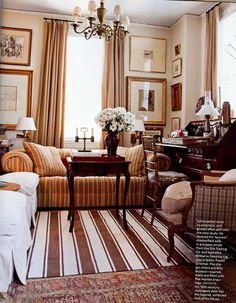 striped rug over persian rug, interesting