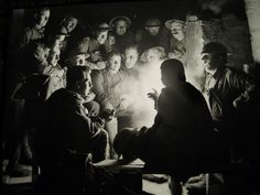 Soldiers of the 1st Australian Divison tell stories by lamplight. Ypres, 1917. credit Frank Hurley https://www.facebook.com/pages/As-tears-petrified-in-the-ground-14-18-WWI/610711125633069