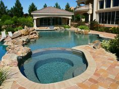 This outdoor space is perfect for entertaining and enjoying the summer heat.