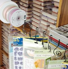 Add clip rings or curtain hooks to a towel bar or a simple curtain wire, to organize ribbon, stickers and much more.