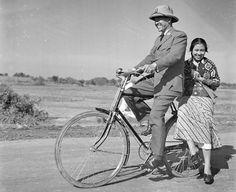 Just simply Bung Karno riding a bicycle with his beloved wife, Ibu Fatmawati.