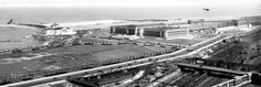 By 1930, Grant Park's Museum Campus held the Field Museum of Natural History, and the newly built Shedd Aquarium and Adler Planetarium. Columbus Drive divides the photo.