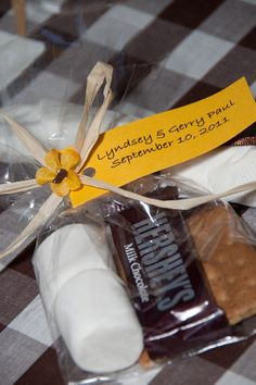 S'more wedding favors. This would be so cheap! we could have a bonfire after and they could use the smore kit or keep it