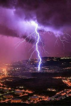 Daredevil Photographer Captures Surreal Lightning Strikes (PHOTOS) Severe weather chaser and photographer Marko Korosec uses his skills to find himself in the right place at the right time to capture incredible images of lightning. Ride The Lightning, Thunder And Lightning, Lightning Strikes, Lightning Bolt, Lightning Storms, Purple Lightning, Image Nature, All Nature, Science And Nature