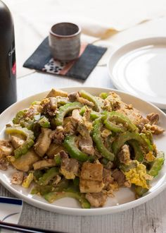 A super easy Japanese stir fry from Okinawa, goya chanpuru is full of bonito flakes, which is unique for a stir fry dish and so flavoursome that you will get addicted to it. It is not greasy at all and my version is made with pork slices instead of SPAM which is the real version of goya chanpuru. Stir Fry Dishes, Stir Fry Recipes, Raw Food Recipes, Asian Recipes, Healthy Recipes, Healthy Food, Bitter Melon Recipes, Okinawa Food, Eggplant Recipes