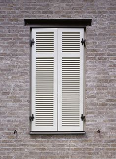 Faux window with real shutter with wood beam on top