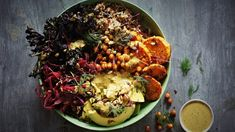 Sweet potato and kale bowl with quinoa, coriander tahini dressing and crispy chilli-lime chickpeas