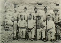 A group of the Royal Marine Light Infantry  members who assisted during the defense of the British Legation during the Boxer Rebellion, Peking, 1900.