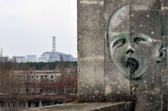 Graffiti adorns a wall April 4 in the ghost city of Pripyat near the fourth nuclear reactor (background) at the former Chernobyl Nuclear power plant, site of the world& worst nuclear disaster. Chernobyl Nuclear Power Plant, Chernobyl Disaster, Nuclear Energy, Socotra, Ghost City, Ghost Towns, Abandoned Buildings, Abandoned Places, City Buildings