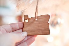 Adorable I heart Oregon ornament. Hang it on your tree, in your car or anywhere to remind you where your heart is. Made of bamboo and jute rope. Measures: