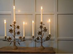 Antique French candlesticks originally from an old Monastery. They have a wonderful aged patiner to the metalwork. Perfect for a dining table, mantlepiece or hallway.